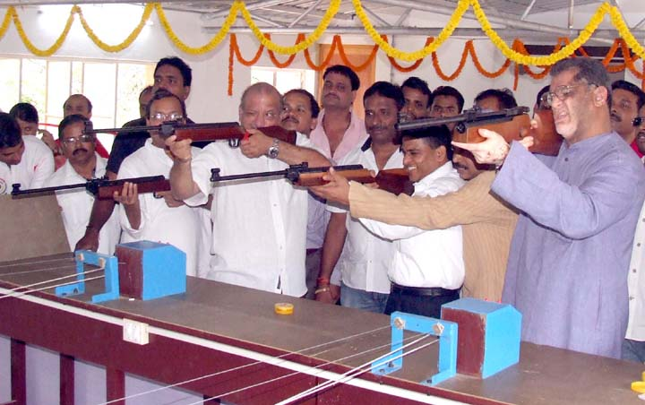 Ministers aim for the target at the new indoor shooting range in Bhubaneswar on March 17, 2010.