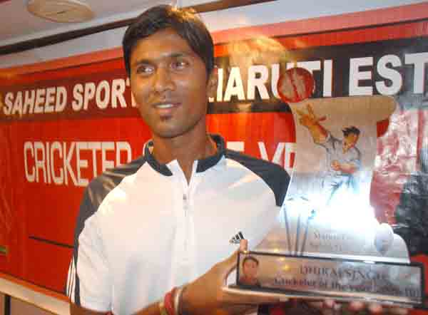 Dhiraj Singh poses with the Maruti Estate Saheed Sporting Cricketer of the Year Award   in Bhubaneswar on April 11, 2010.