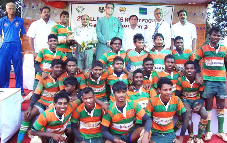 Players of KISS pose with their runners-up trophy at the All-India Under-16 Rugby tournament in Bhubaneswar on April 30, 2010.