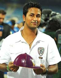 India spinner Pragyan Ojha poses with the purple cap after becoming the highest wicket-taker of IPL in April 2010.