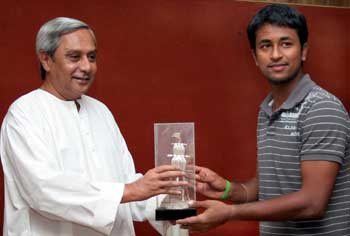 India spinner Pragyan Ojha is being felicitated by Orissa Chief Minister Naveen Patnaik in Bhubaneswar on July 11, 2008.