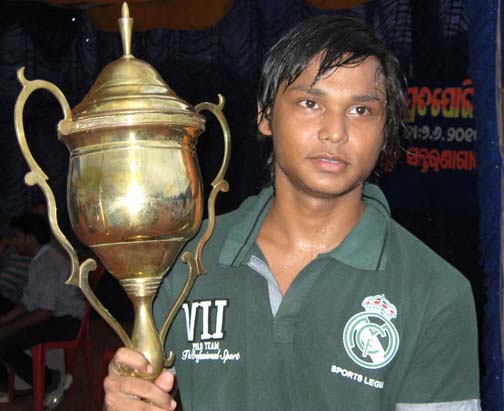 Chintan Naik with the trophy as best swimmer of Orissa in Bhubaneswar on June 7, 2010.