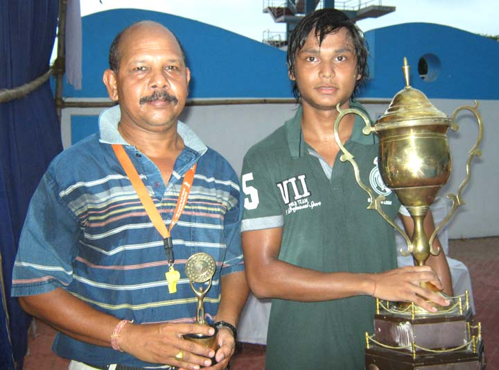 Coach Surendra Kumar Naik (L) and his son Chintan Naik with their trophies in Bhubaneswar on June 7, 2010.