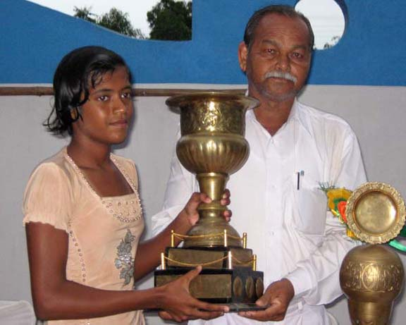 Niharika Patel receives the trophy as the best woman swimmer of the State championship in Bhubaneswar on June 7, 2010.