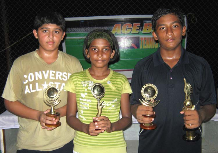 Title winners (left to right) Nishant Thacker, Komal Vishakha and Abhilash Sahoo at the 2nd Ace-Base Tennis Tournament in Bhubaneswar on June 6, 2010.