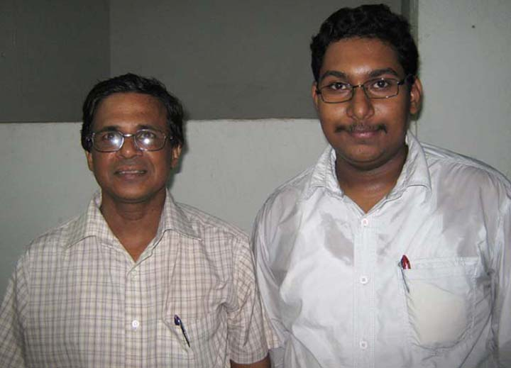 Former Orissa State Chess Association secretary Gagan Behari Dash (L) with his son Sanket Sagar Dash in Bhubaneswar on June 16, 2010.