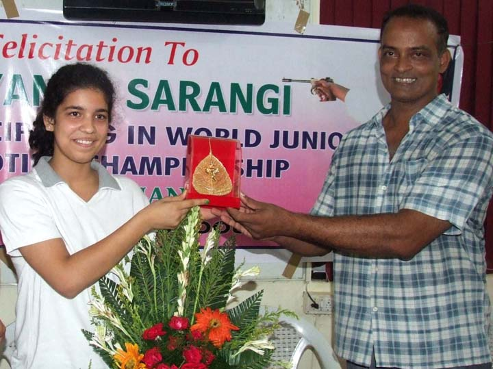 Utkal Karate School founder H P Pattanayak felicitates international shooter Shriyanka Sadangi (left) in Bhubaneswar on June 26, 2010.