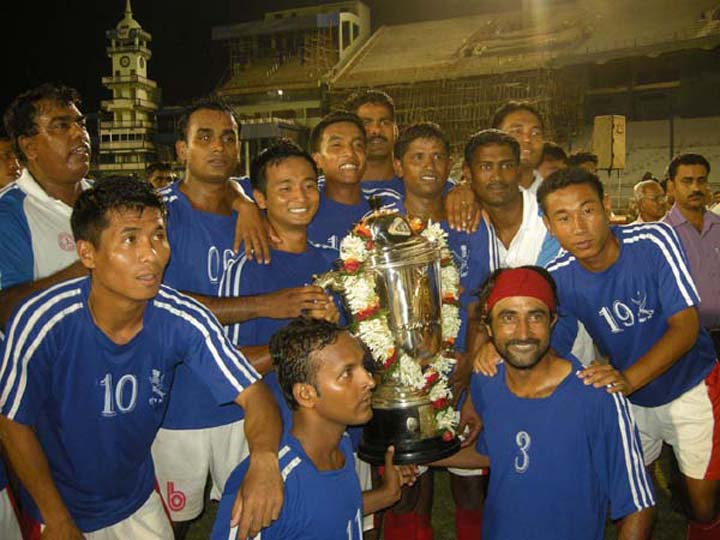 Players of Army XI celebrate afer winning the Kalinga Cup All-India Football Tournament in Cuttack on July 10, 2010..