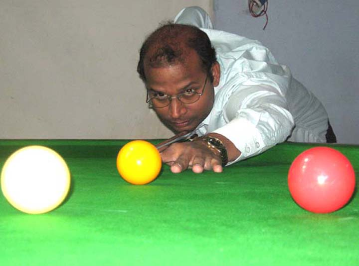 Debasish Mohanty plays his quarterfinal match in the State Senior Billiards Championship in Bhubaneswar on July 6, 2010.