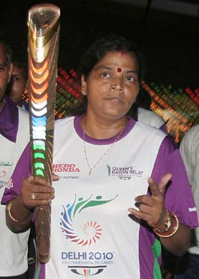 Orissa cyclist Minati Mohapatra runs with the Queeen`s Baton for the Delhi Commonwealth Games, in Bhubaneswar on August 9, 2010.