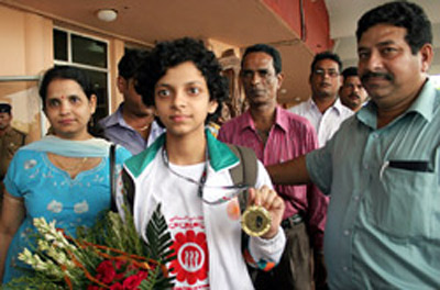 Padmini Rout show her Asian Youth Chess Championship gold medal on arriving in Bhubaneswar on 23rd July, 2008.