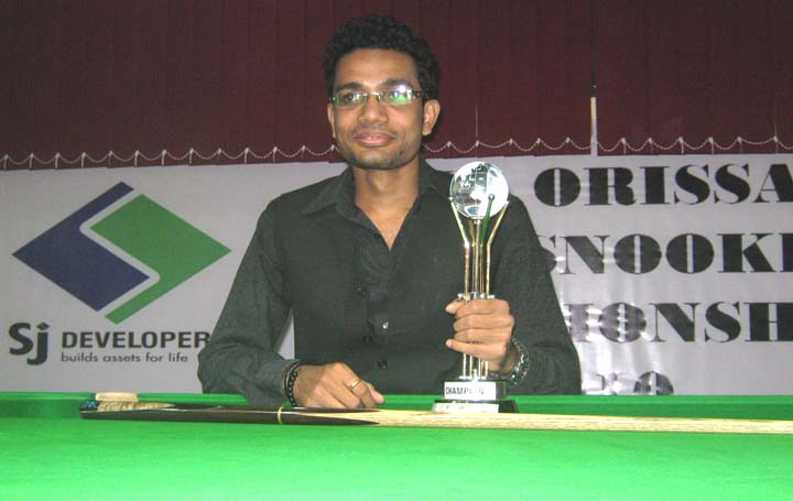 Rakesh Roshan Pradhan with the trophy after winning the SJ Cup Snooker Tournament in Bhubaneswar on August 14, 2010.