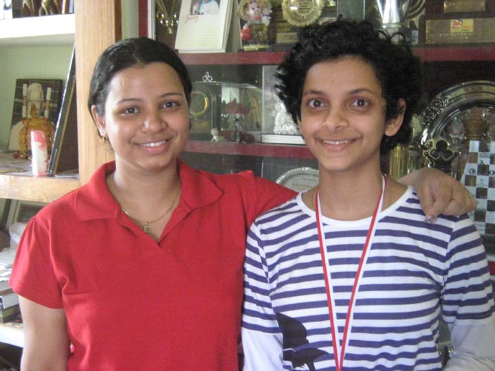 Padmini Rout (R) with her elder sister Emilee at home in Bhubaneswar on August 29, 2010.