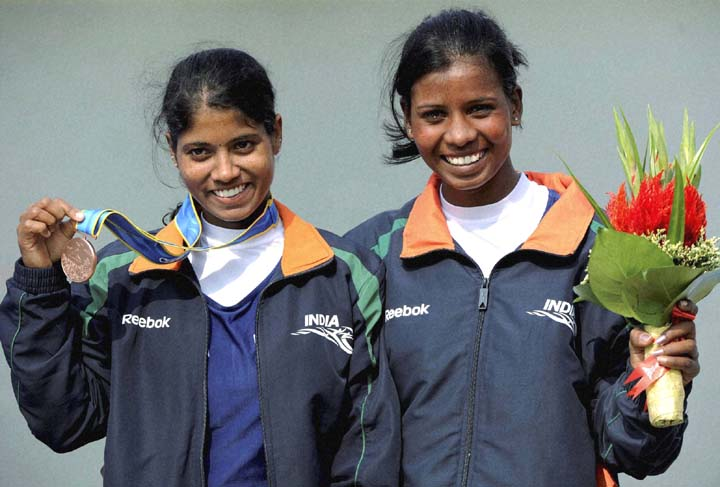 Orissa rowers Pratima Puhana (Left) and Pramila Prava Minz pose after winning bronze medal in 16th Asian Games at Guangzhou on November 19, 2010.