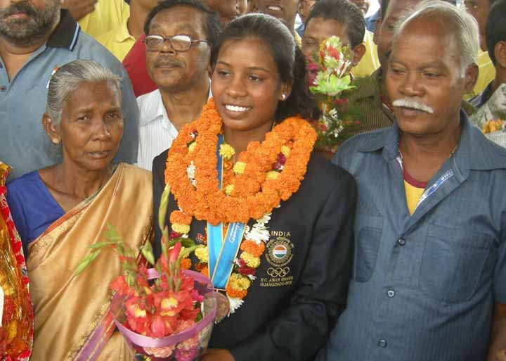 Asiad rowing bronze medallist Pramila Prava Minz with her parents at Cuttack on November 23, 2010.