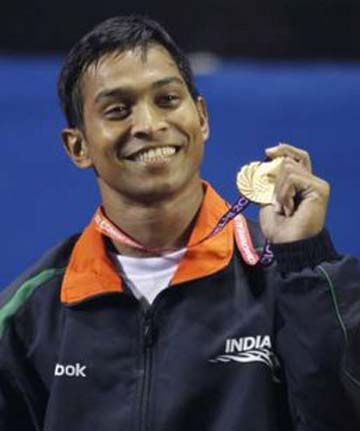 Weightlifter K Ravi Kumar displays his Commonwealth Games gold medal in 2010.