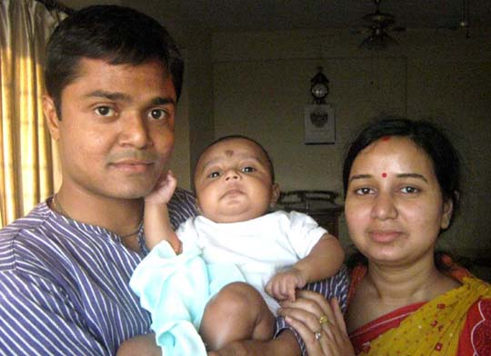 Sports journalist Tapan Mohanta with wife Rinky and son Pranayaditya at home in Kolkata on March 16, 2011.