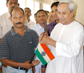 Chief Minister Naveen Patnaik wishes Ganesh Jena good luck for his Mount Everest expedition on March 30, 2011.