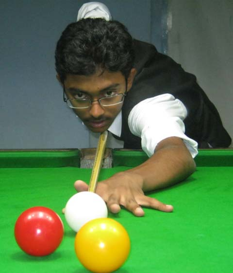 Ashutosh Padhy in action at the State Billiards and Snooker Championship in Bhubaneswar on June 18, 2011.