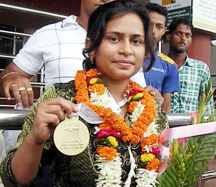 Aparajita Gochhikar with her Commonwealth championship gold medal in Bhubaneswar on July 7, 2011.