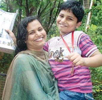 National u-7 chess champion Sambit Panda with his mother in   Bhubaneswar on July 27, 2011.