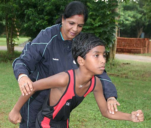 Budhia Singh getting tips from coach Rupanwita Panda in Bhubaneswar on July 30, 2011.