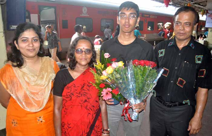 Orissa chess player Swayams Mishra with his parents and   sister in Bhubaneswar on September 27, 2011.