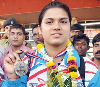 Orissa lifter Subhasmita Mohanty displays her Commonwealth medals in Bhubaneswar on October 18, 2011.