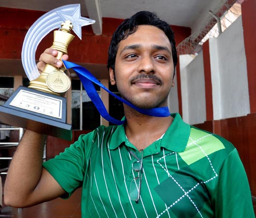 Anwesh Upadhya displays his Buddhi international trophy in Bhubaneswar on October 13, 2011.