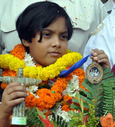 Saina Salonika gets warm reception on her return home after winning a bronze medal in the World Youth Chess Championship in Brazil on Novembe 30, 2011.