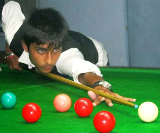 Chirag Arora in action during the junior snooker final in Bhubaneswar on Dec 1, 2011.