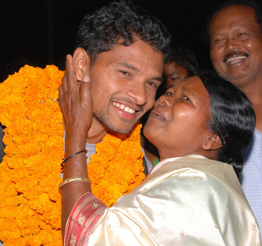 Odisha hockey international Birendra Lakra is hugged by his mother Merry in Rourkela on Feb 28, 2012.