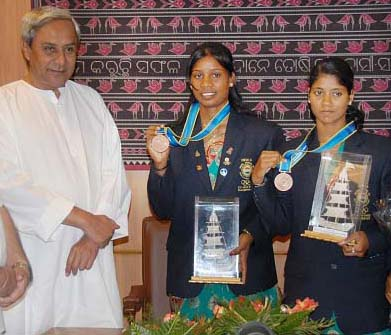 Orissa rowers Pratima Puhana (Right) and Pramila Prava Minz with Chief Minister Naveen Patnaik in Bhubaneswar in November 2010.