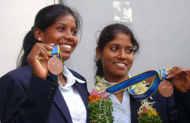 Orissa rowers Pratima Puhana (Right) and Pramila Prava Minz pose after winning bronze medal in the 16th Asian Games at Guangzhou on November 19, 2010.