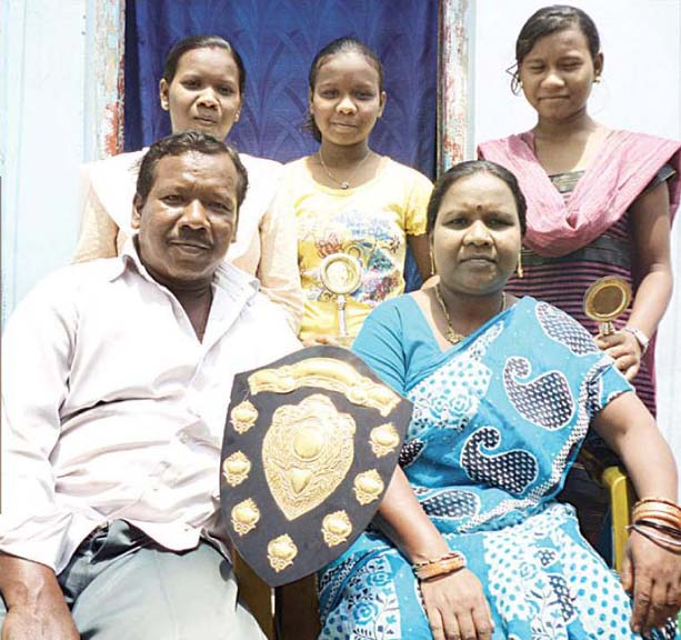 File photo of Odisha weightlifters Jayanti Devi with her husband and three daughers.