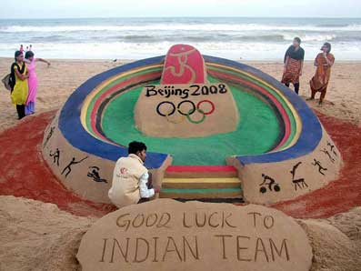 Sand artist Sudarsan Pattnaik gives finishing touch to his Olympic Stadium at the Puri beach on 06-08-2008