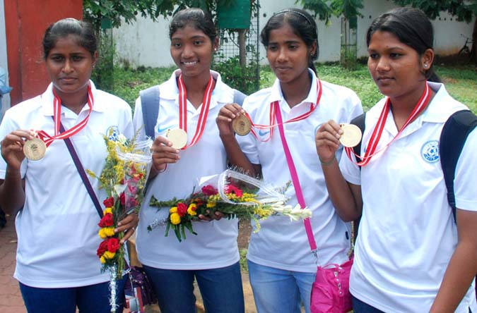 Odisa players (Left to right) Alochana Senapati, Lochana Munda, Supriya Routray, Sita Sharma of SAFF title winning Indian women football team in Bhubaneswar on Sept 17, 2012.