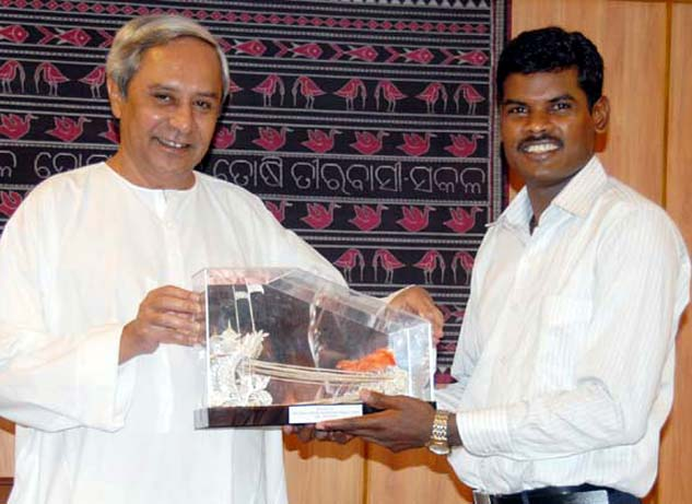 Hockey Olympian Ignace Tirkey with Chief Minister Naveen Patnaik in Bhubaneswar on May 26, 2010.