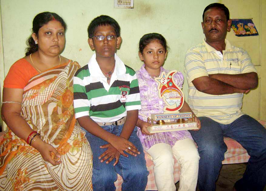 Rutumbara Bidhar with her parents and brother in Bhubaneswar on Oct 18, 2010.
