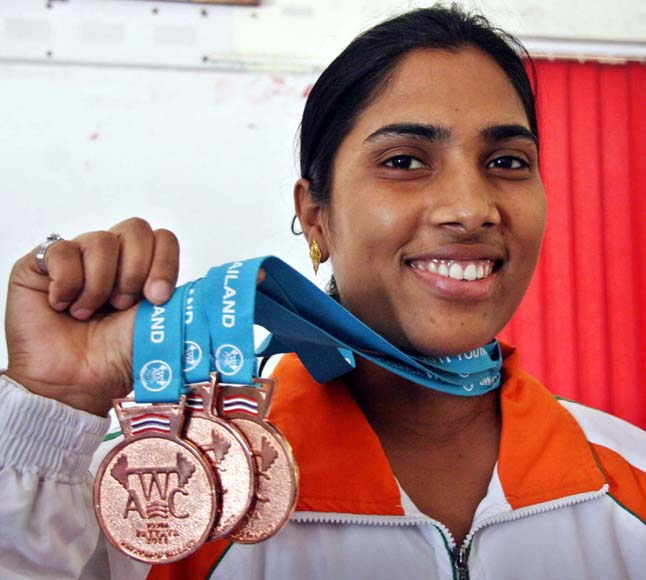 Odisha woman lifter Kiran Kumari Digal shows her Asian Youth bronze medals in Bhubaneswar on March 17, 2013.