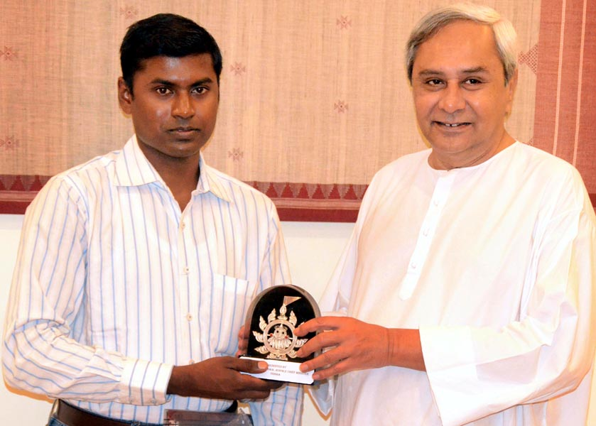Chief Minister Naveen Patnaik felicitates mountaineer Yogabyasa Bhoi in Bhubaneswar on May 17, 2013.