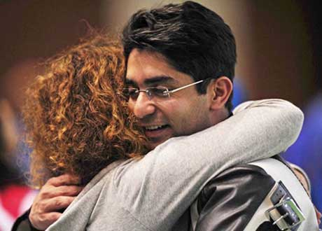 Abhinav Bindra gets a hug from his coach after winning the first-ever individual Olympic gold medal in Beijing on August 11, 2008.