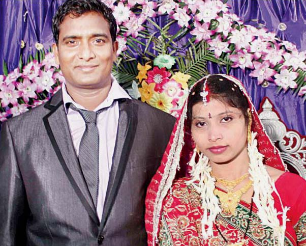 Odisha cricketer Niranjan Behera with his wife Swagatika on the occasion of their marriage reception in Cuttack on July 19, 2013.