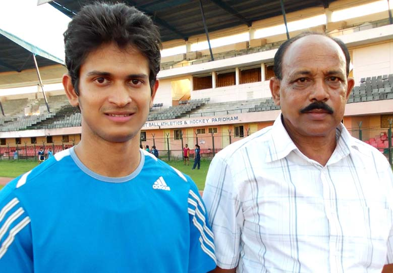 Odisha sprinter Amiya Mallick with coach N M Deo in Bhubaneswar on Sept 13, 2013.