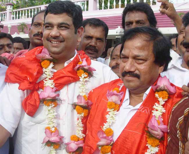 Ranjib Biswal (left) and Asirbad Behera celebrate after their victory in the Orissa Cricket Association election at Cuttack on August 17, 2008.