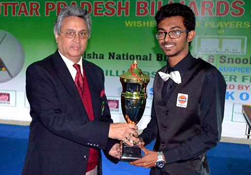 Ashutosh Padhy receives the junior National snooker trophy in Lucknow on February 23, 2014.