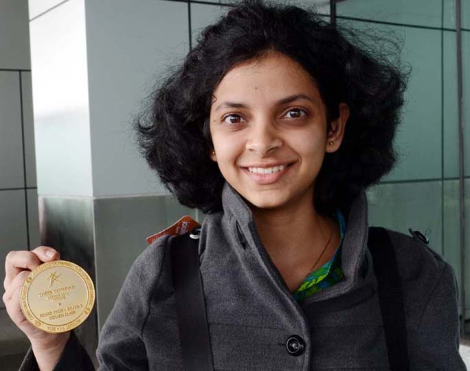 Odisha WGM Padmini Rout shows her Olympiad gold medal in Bhubaneswar on August 17, 2014.