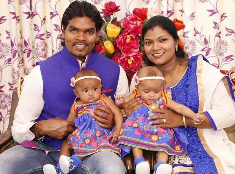 Hockey internatiironal Prabodh Tirkey with his wife Sweta and their twin daughters in October, 2014.