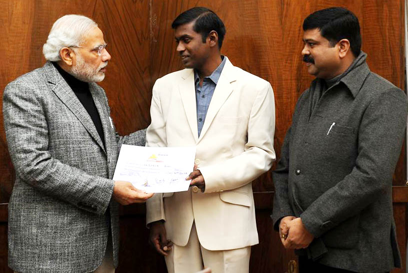 Odisha mountaineer Jogabyasa Bhoi with Prime Minister Narendra Modi and Petroleum Minister Dharmendra Pradhan in New Delhi on December 19, 2014.