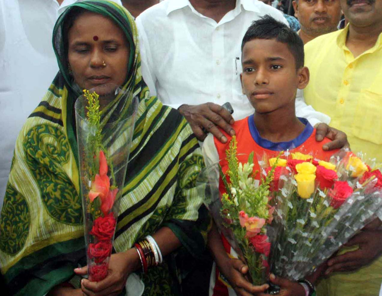 Football pridigy Chandan Nayak with his mother in Bhubaneswar on August 5, 2016.